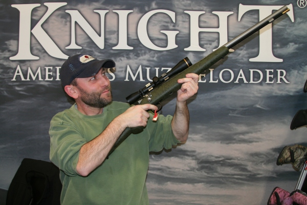 A 6-pound .50-caliber muzzleloading rifle with a Kevlar stock is hefted by a shooter at the Knight Rifle booth at the Shot Show.