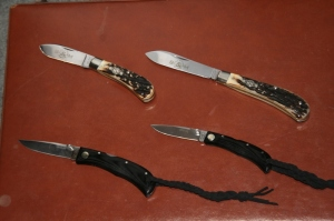 Top Kentucky Shiner Pint and Quart and bottom QTAC I and II of QS's new tactical knives.